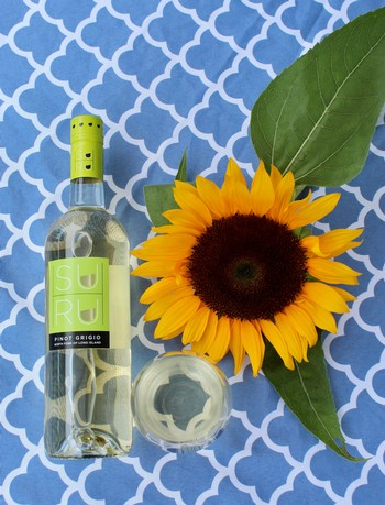 Suhru Pinot Grigio glass and bottle with sunflower